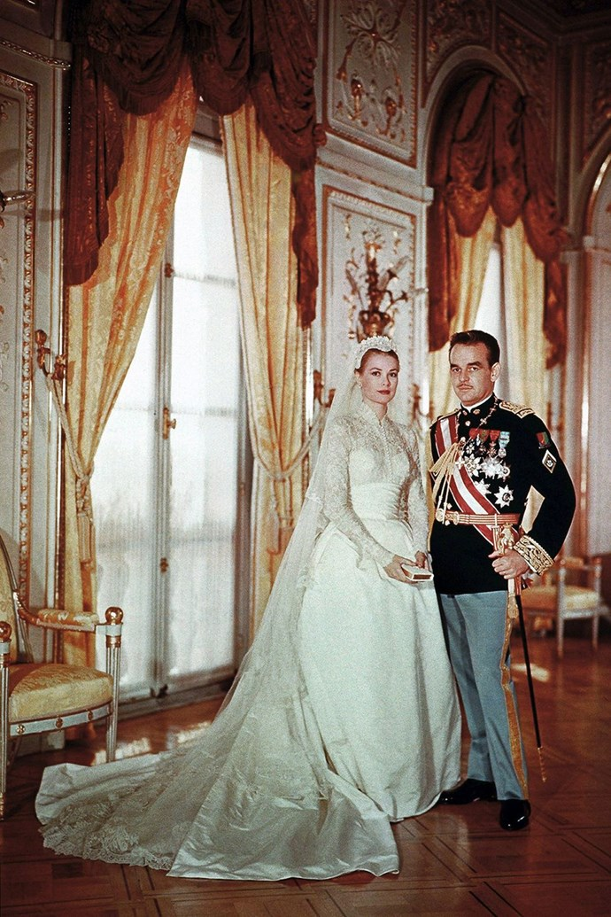 "**1956: Grace Kelly and Prince Rainier III** <br><br> At 26, Kelly traded in the glitzy world of Hollywood for the life of a princess when she married Prince Rainier III of Monaco in 1956 in what is still known as the ""wedding of the century."" The bride's lavish wedding gown was designed by Helen Rose of MGM and included a pearl-encrusted prayer book that was embedded into the dress, because #royals."