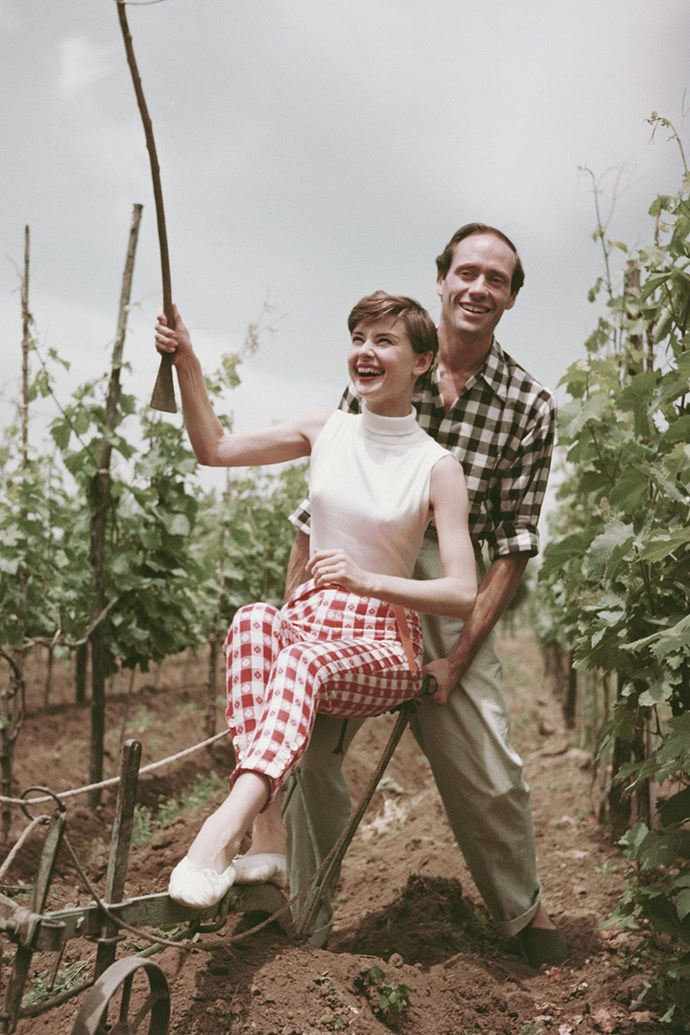 **1954: Audrey Hepburn and Mel Ferrer** <br><br> Some eight months after co-starring on Broadway together, Hepburn and Ferrer tied the knot in Switzerland, and starred in the film version of *War and Peace* the following year. The couple enjoyed a 14-year marriage that included a son, Sean Hepburn Ferrer.