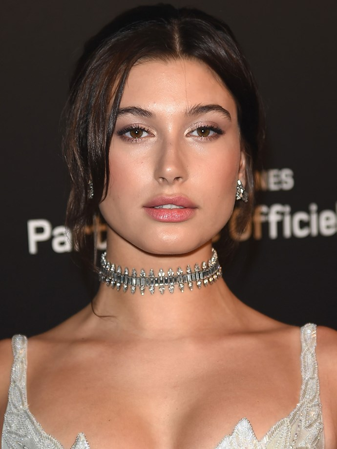 While her Met Gala look may have looked a little harsh, Hailey softened her brunette look with tousled bangs, lightly lined eyes and a glossy lip.
