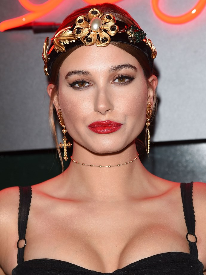 Between the red lip, dark pulled-back hair and winged eye, we're getting major Dolce & Gabbana vibes.