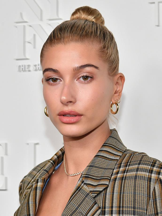 We are all here for Hailey's minimal makeup look, keeping it to a swipe of gloss on the lips, a touch of pale pink shadow, and a lit-from-within glow.
