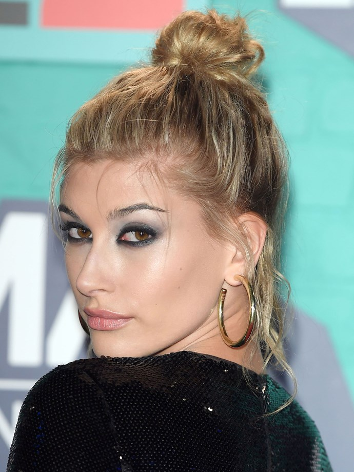 Taking her smoky eye slighty darker, HB paired her blue-toned shadow with a high bun and messy tendrils framing her face.