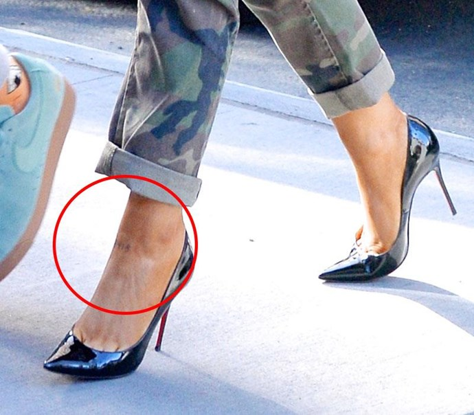 Ariana Grande had four tiny numbers tattooed on to her left ankle, reading 8418 — which is Pete Davidson's late dad's official New York City Fire Department number.