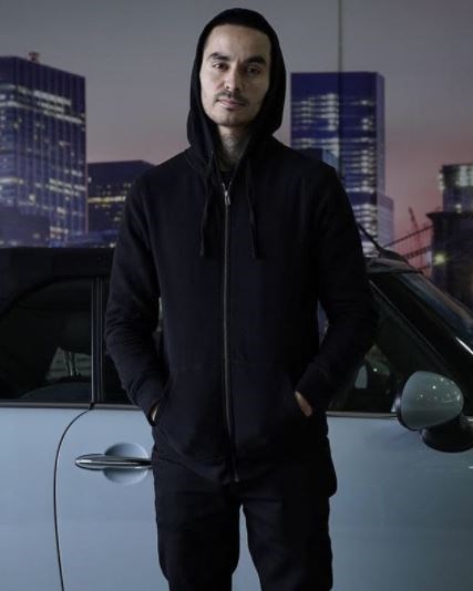 In a hoodie NOT having a giggle.  (Photo: Netflix)