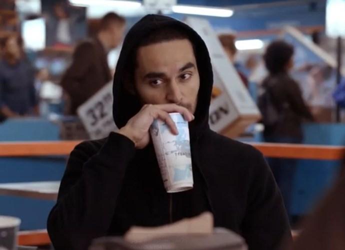 Enjoying a beverage.  (Photo: Netflix)