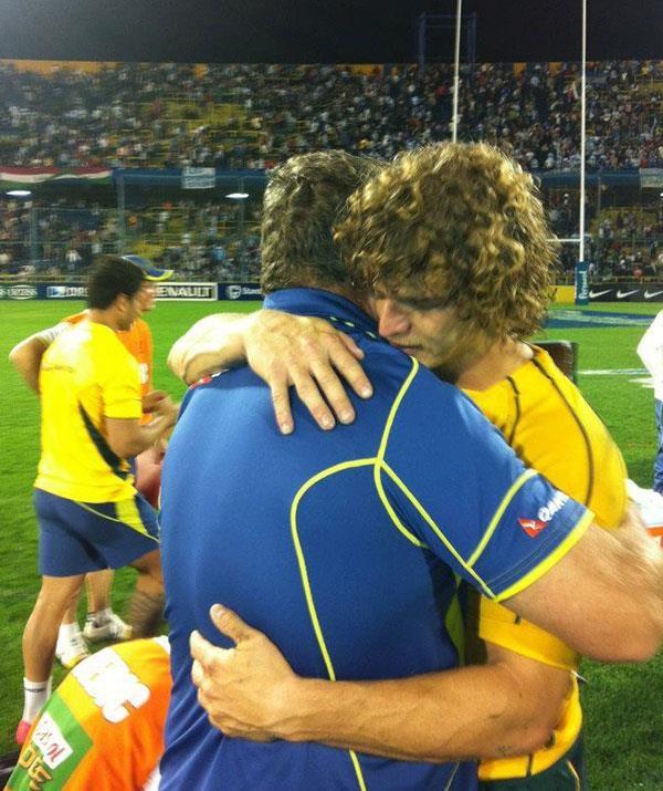Nick hugging his dad.   (Photo: Facebook)
