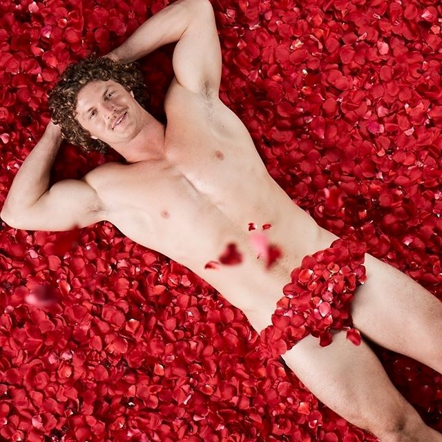 When there's a ripped dude laying on a bed of roses, using delicate petals to barely cover his manhood, we WILL be aroused.