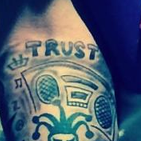 """Trust""  Another day, another bad font that lives in the crook of Bieber's arm. JK, I don't mean to be a hater. It's just...there have to be better typeface options, right?"