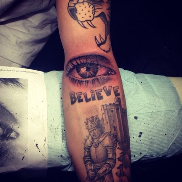 "His Mom's Eye **Location:** Inner arm.  Justin got his mom eye tattooed in the crook of his arm, because ""Moms always watching,"" as he put it on Instagram. This was...an interesting decision."