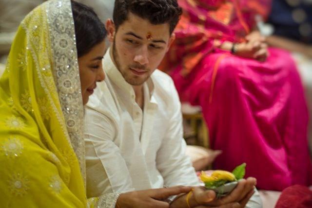 Priyanka looks so serene, and Nick looks SO into his fiancée.
