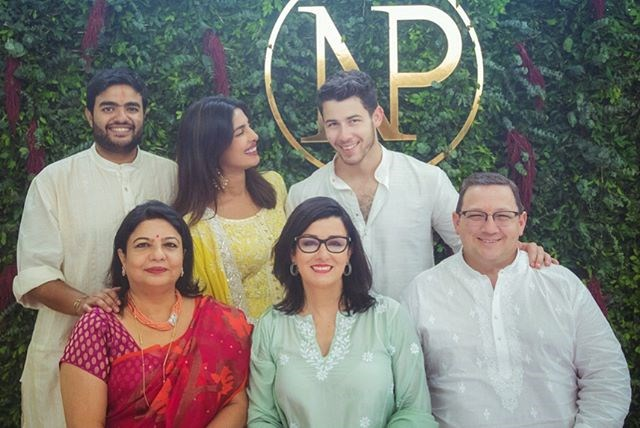 Priyanka and Nick surrounded by their parents.