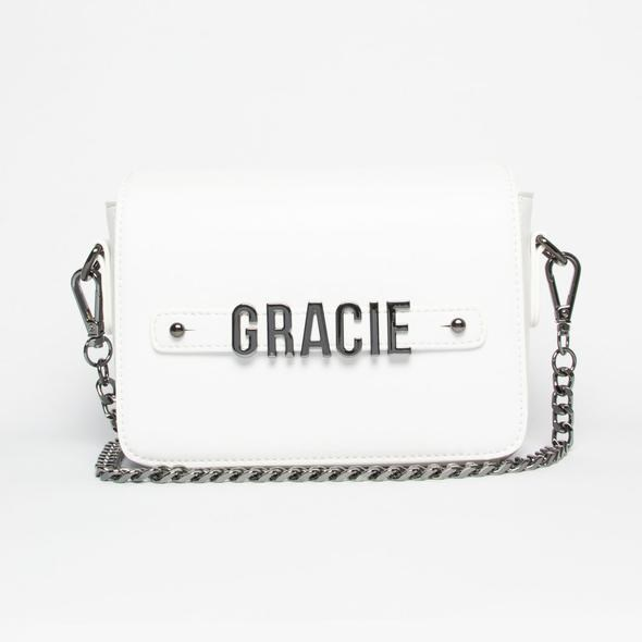 "White Crossbody Bag with Personalised Hardware, $149, from [St.Oddity](https://stoddity.com/collections/crossbody-bags/products/galaxy-crossbody-bag-with-personalised-hardware|target=""_blank""