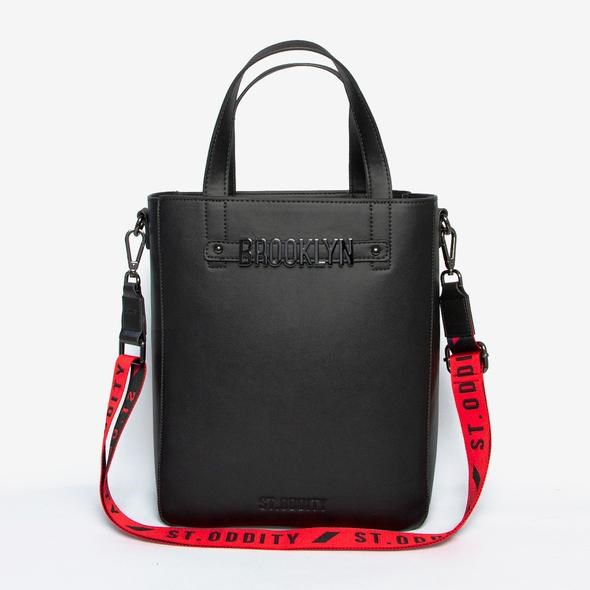 "Tote in Black with Personalised Hardware, $199, from [St.Oddity](https://stoddity.com/collections/tote-bags/products/tote-in-black-with-personalised-hardware-and-street-strap-in-red|target=""_blank"")."