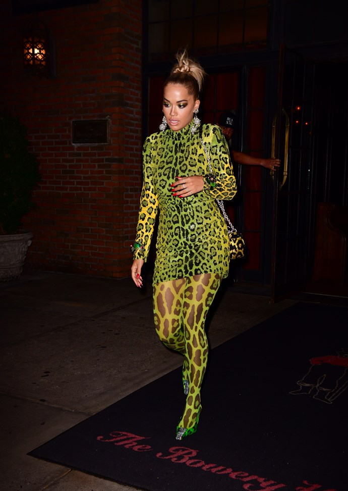 Rita Ora wears a neon Tom Ford leopard to a pre-VMAs party.