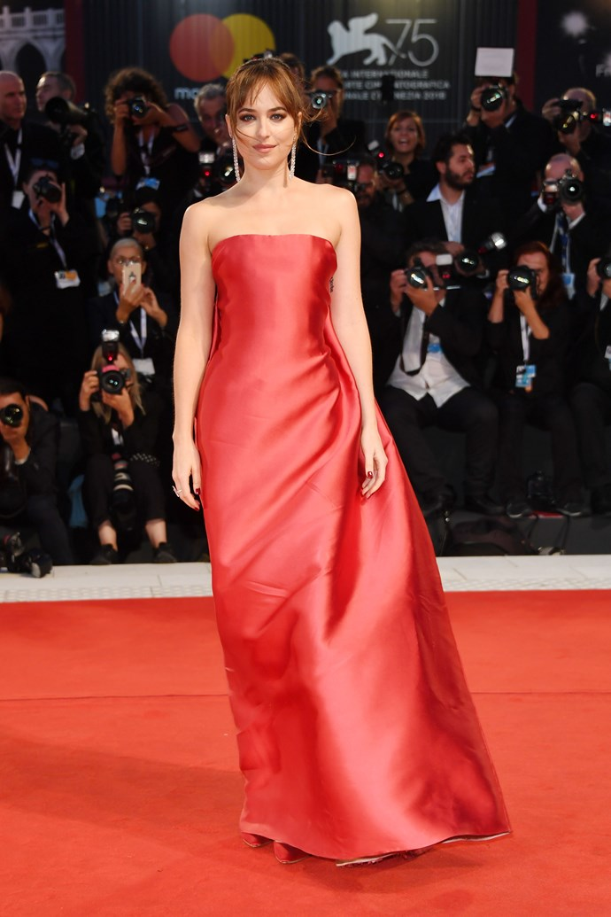 Dakota Johnson's red dress at Venice Film Festival.