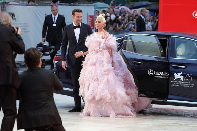 Hunk'o'spunk Bradley Cooper ushering Gaga out of the car.