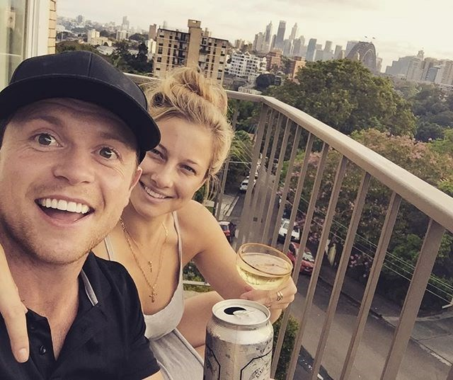 """Clearly things got pretty serious as Romy shared a pic on her Instagram of her and Hugo after moving in together. She captioned this photo with, """"Cheers to moving in and putting my favourite vintage champagne glasses to use!!!"""""""