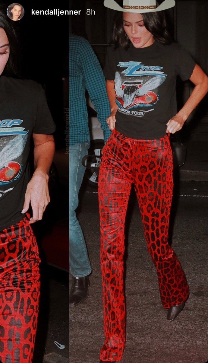 "Kendall rocking her cowboy hat with a rock'n'roll tee and red animal print pants. Get the look [HERE](https://www.prettylittlething.com.au/mandarin-snake-print-slinky-flares.html|target=""_blank""