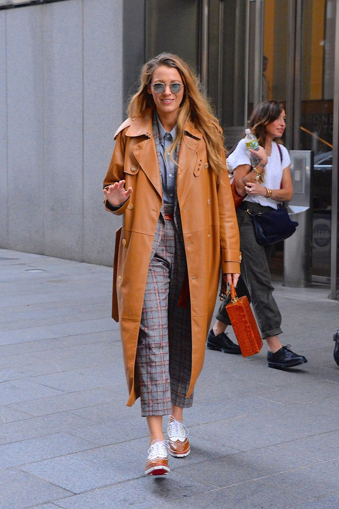 In a leather trench coat, brogues and a casual checked suit.