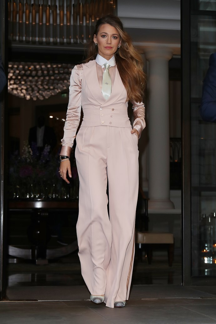 In pastel pink with a white satin tie.
