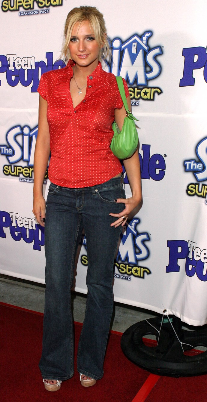 We dare you to find a more quintessentially 2000s image than this pic of Ashlee Simpson with her shoulder bag and flare jeans at a party for *The Sims* and *Teen People*.