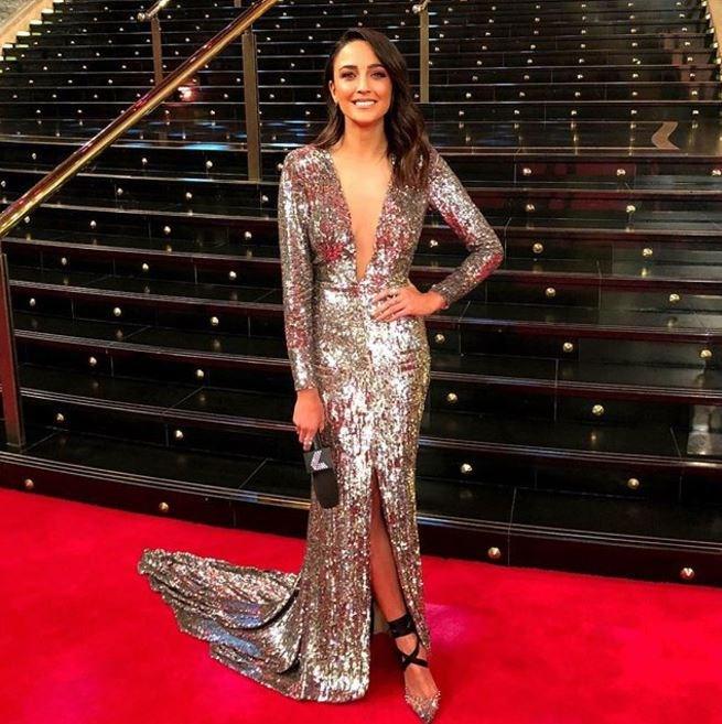 Channel Seven presenter Abbey Gelmi has a J.Lo moment in gold.