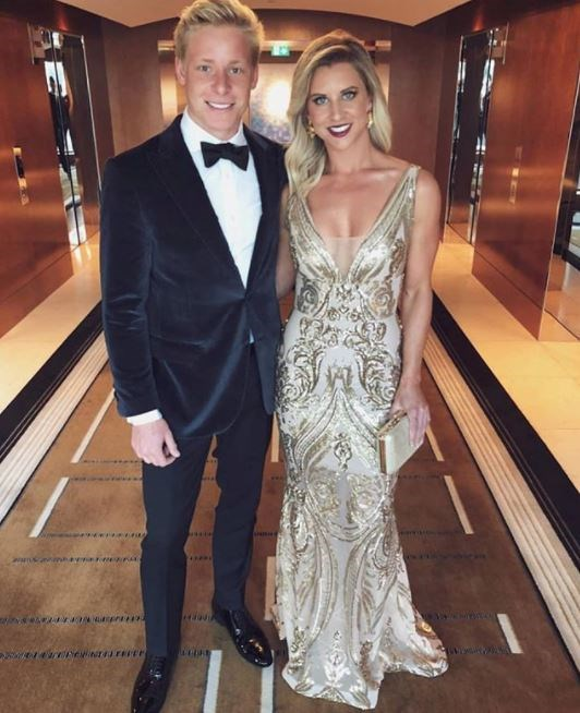 Lauren Houghton and boyfriend Isaac Heeney (a Swans player) get the required elevator lobby shot.