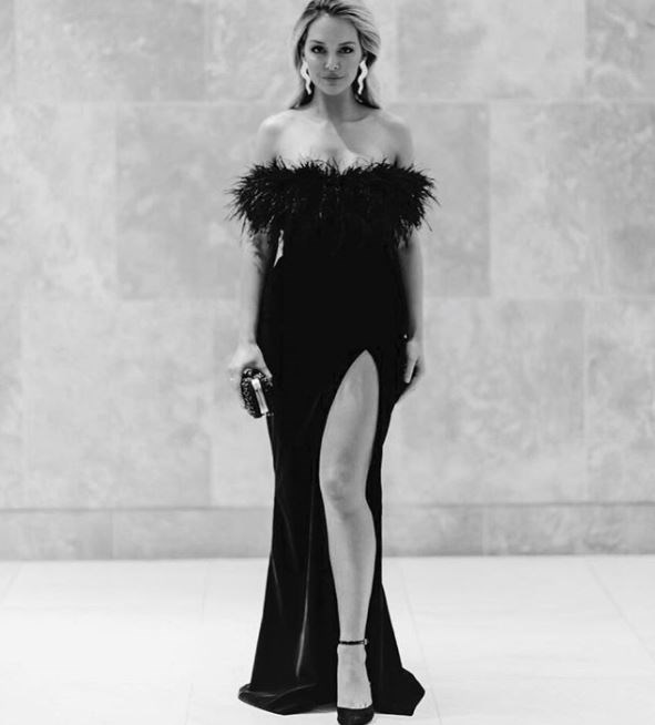 Kelly Beams giving off Bond girl vibes in fluffy Elly Sofocli.
