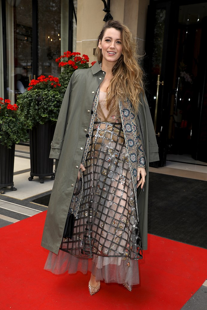 Blake Lively popped two coats on top of her nearly-naked look, making this outfit more layered than a goddamn trifle.