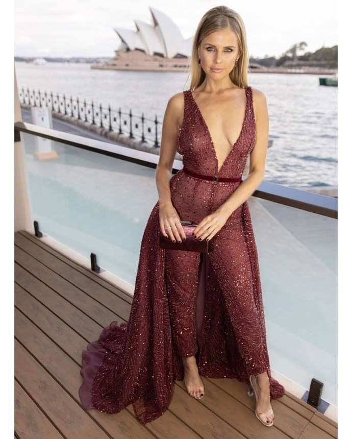 Tegan Martin wearing a Cassandra Renee Couture jumpsuit, Affinity Diamonds Jewels,  Tony Bianco shoes and Olga Berg Official Clutch.