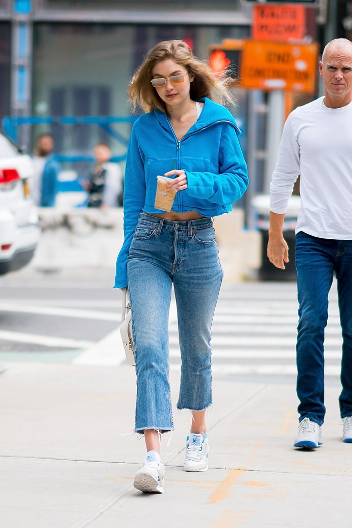 No one has ever made  mom jeans, a hoodie and sneakers look so chic.