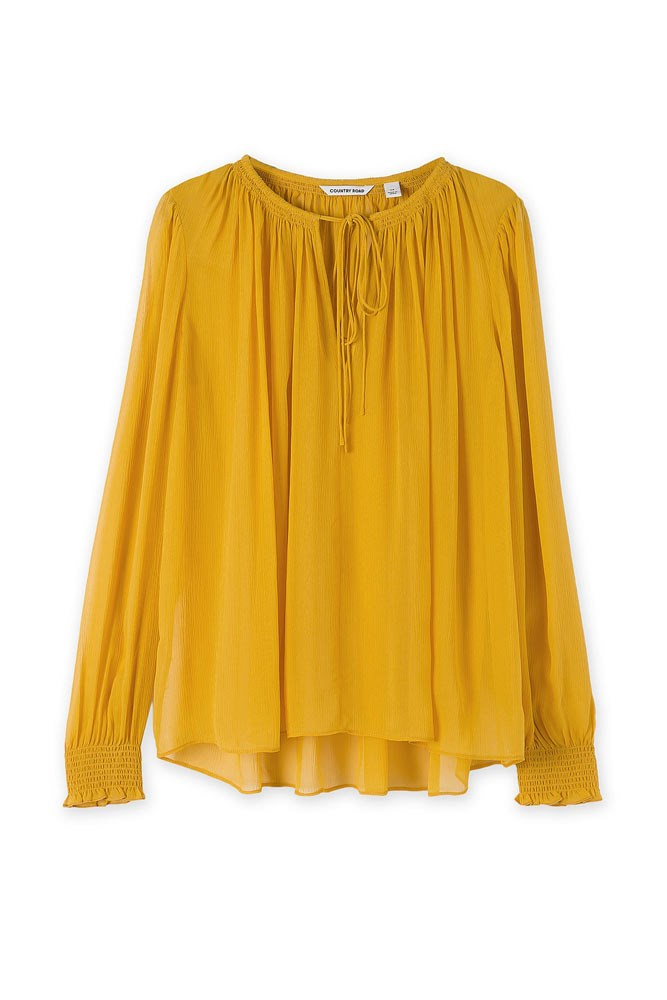 A beautiful blouse in a statement colour is a thoughtfully stylish gift.   *Blouse, $199, [Country Road](https://www.countryroad.com.au/shop/woman/clothing/shirts/60207847/Ruched-Silk-Blouse.html)*