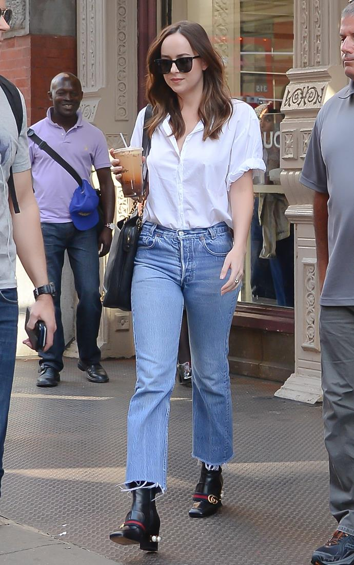 Of course, we've seen the old blue jeans, white shirt combo before, but Dakota's addition of those incredible Gucci boots, plus the oversized Chanel tote is next level cool. And she wasn't even trying.