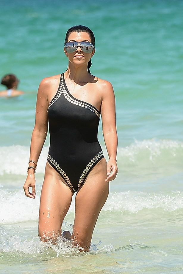 Kourtney Kardashian looks slick in futuristic silver shades.