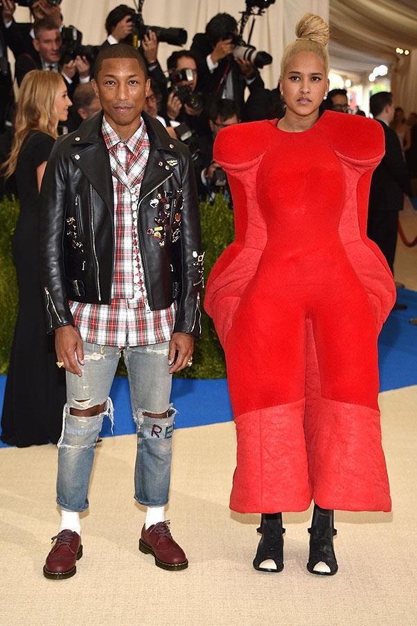 Pharrell Williams and Helen Lasichanh, both in Comme des Garçons.
