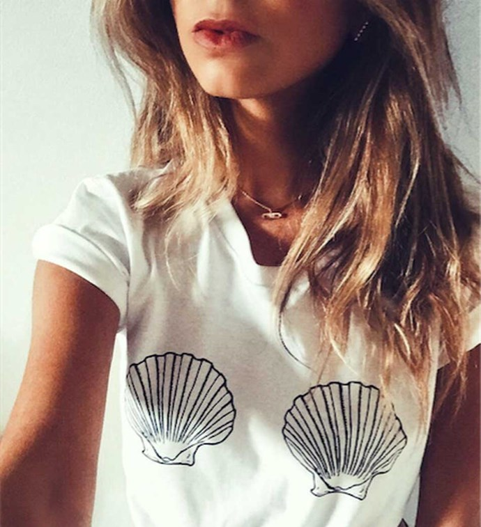 """Tee, $49 (approx.) at [Cuppa Tee Store](https://cuppateestore.com/products/sea-shell-bra-t-shirt-sea-shell-boobs-shirt