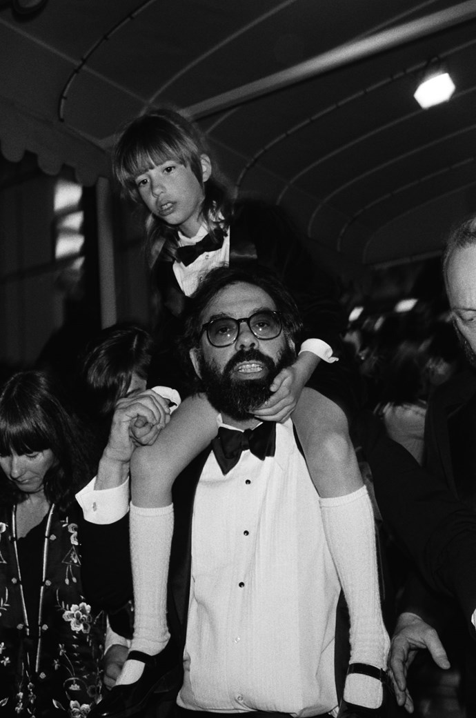 **FRANCIS FORD COPPOLA AND SOFIA COPPOLA, 1979**  This is Sofia Coppola wearing a baby tux on the shoulders of her dad. Adorable.