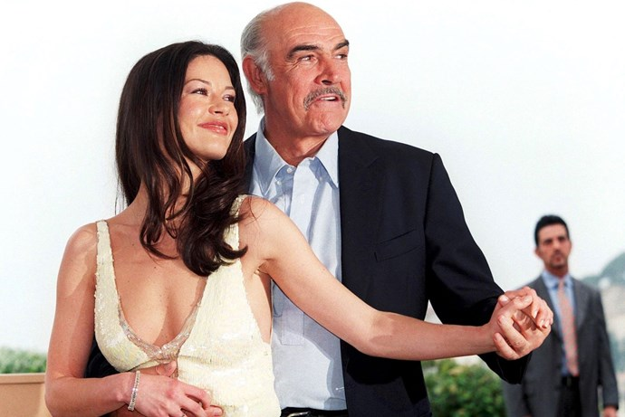 **SEAN CONNERY AND CATHERINE ZETA-JONES, 1999**  The only thing better than this photo? ENTRAPMENT. Seriously, if that shiz is on Netflix, go watch now.