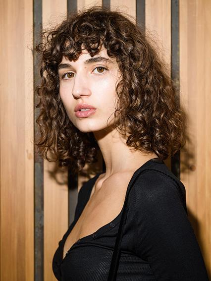 "**Natural curls at Dion Lee**   Who knew a curly fringe could look so chic?  Scrunch a 20-cent piece-sized amount of [Redken Curvaceous Curl Refiner](https://www.adorebeauty.com.au/redken/redken-curl-refiner-250ml.html |target=""_blank""