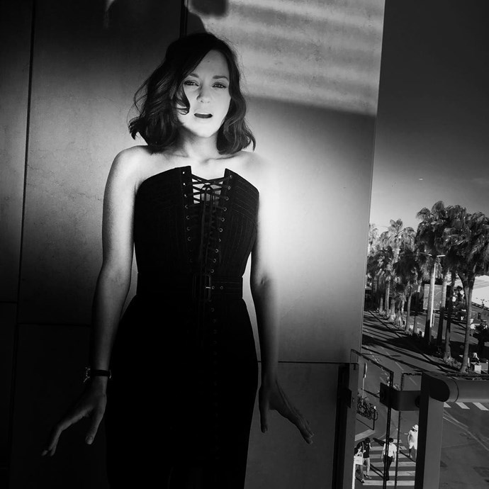 Marion Cotillard was snapped in this candid black-and-white photo.  *Image: [@eliottbliss](https://www.instagram.com/p/BUNfnr0Fl7u/)*