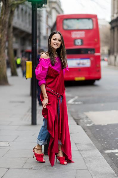 **ANNA VITIELLO**  Editor Anna Vitiello brings a silky DKNY slip dress into spring by layering it over a Rejina Pyo blouse and boyfriend jeans.