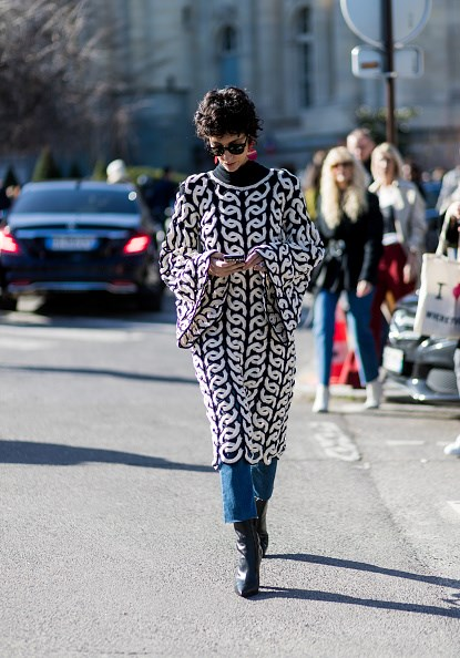 **YASMIN SEWELL**  Street style star Yasmin Sewell's bohemian crochet dress by Chloé adds a '70s feel to her raw hem denim and ankle boots.