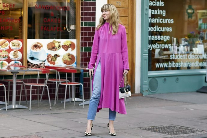 **LISA AIKEN**  Make a thigh-high slit daytime friendly by wearing your favourite denim beneath, like buyer Lisa Aiken in Balenciaga's shocking pink 'strangle' dress.