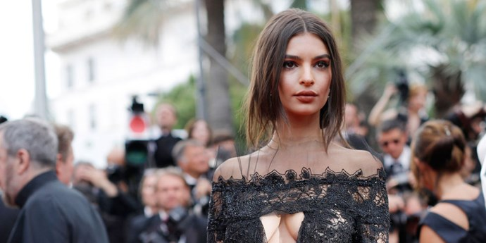 Emily Ratajkowski may have opted for an up-do but it was as low-maintenance as they come, with free-falling strands of hair framing her face.   *Getty Images*