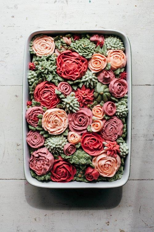 <p><strong>ROSY FIELDS</strong><p> Not into florals you can't eat? This buttercream rose field cake by blogger and author [Molly Yeh](http://mynameisyeh.com/mynameisyeh/2017/4/rose-rose-cake) is the perfect compromise. Delicious, theme-compliant, and totally edible. Yes please.