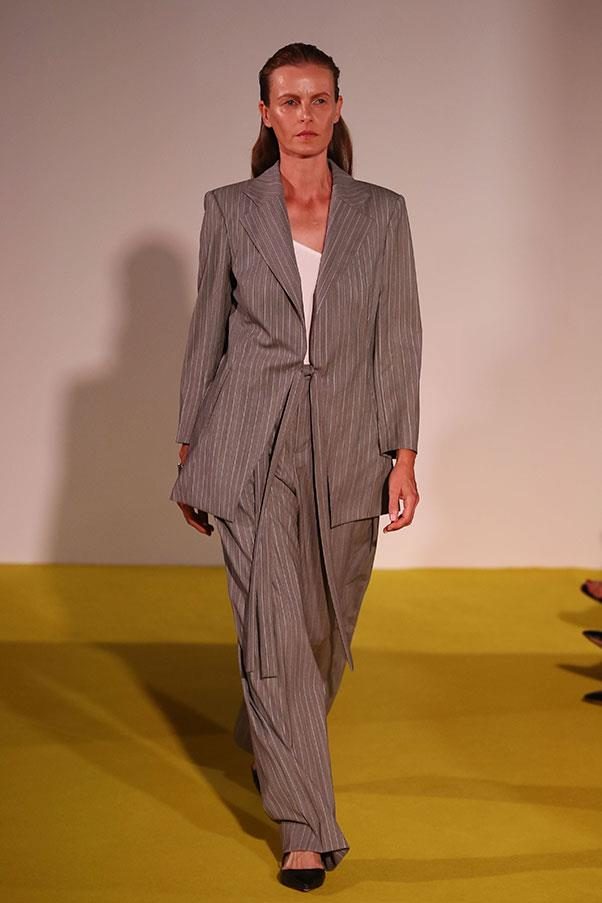 "**Giselle Farhat, founder and buyer at [My Chameleon](https://www.mychameleon.com.au/)**   *The trend:* Women's suits.    *As seen at*: Christopher Esber (pictured), Georgia Alice and Dion Lee.   *The verdict:* ""We all talk about the power of women and I think designers are thinking about it even more now, it's about how women feel when they dress. Women wearing pant suits, particularly in the 90s, was quite a strong and powerful statement and I think this season designers have interpreted their own pant suit for the modern woman.""   *Try the trend by investing in:*  ""A beautiful tailored blazer and pants requires an investment, if we think about the design, fabric and construction, this makes the pieces special and a real classic that will last years."""