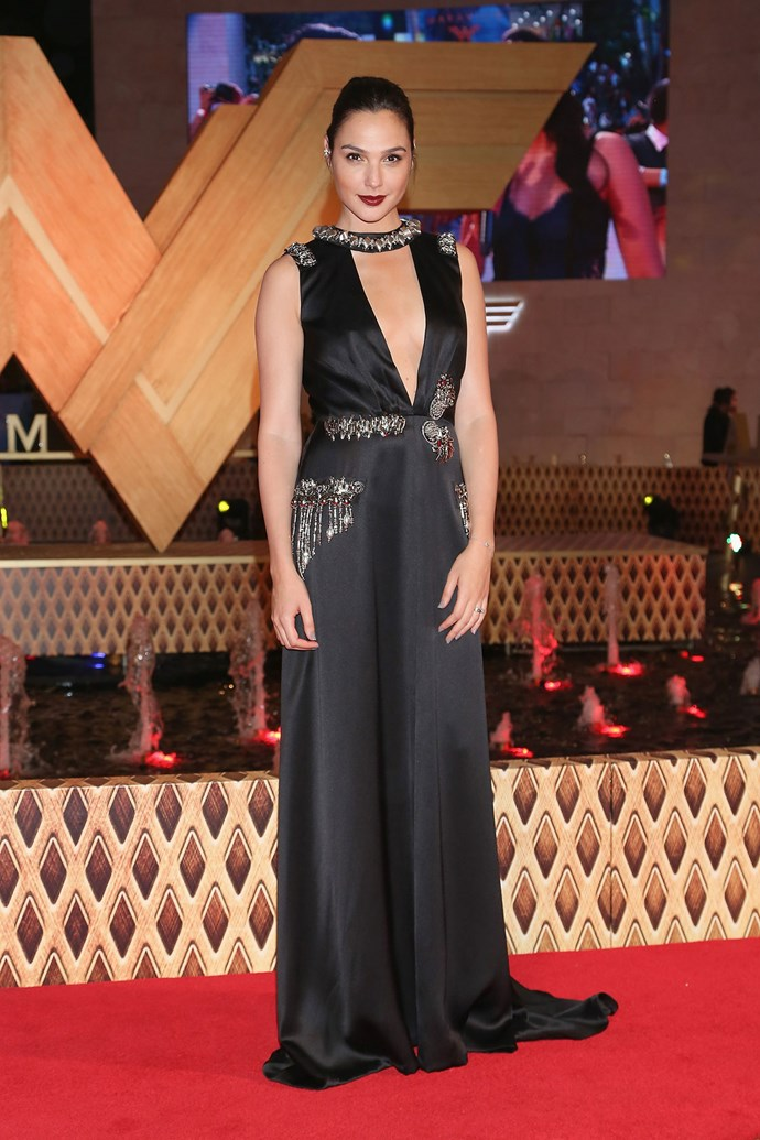 Gal Gadot at the Mexico City *Wonder Woman* premiere in Prada. Unbeknownst to most, Gal wore her gown with a pair of [$39 thongs](https://www.urbanoutfitters.com/shop/rocket-dog-boom-platform?category=womens-sandals&color=001&cm_mmc=CJ-_-Affiliates-_-Skimlinks-_-11389065&utm_medium=affiliates&utm_source=CJ&utm_campaign=Affiliates&utm_term=Skimlinks&utm_content=static).