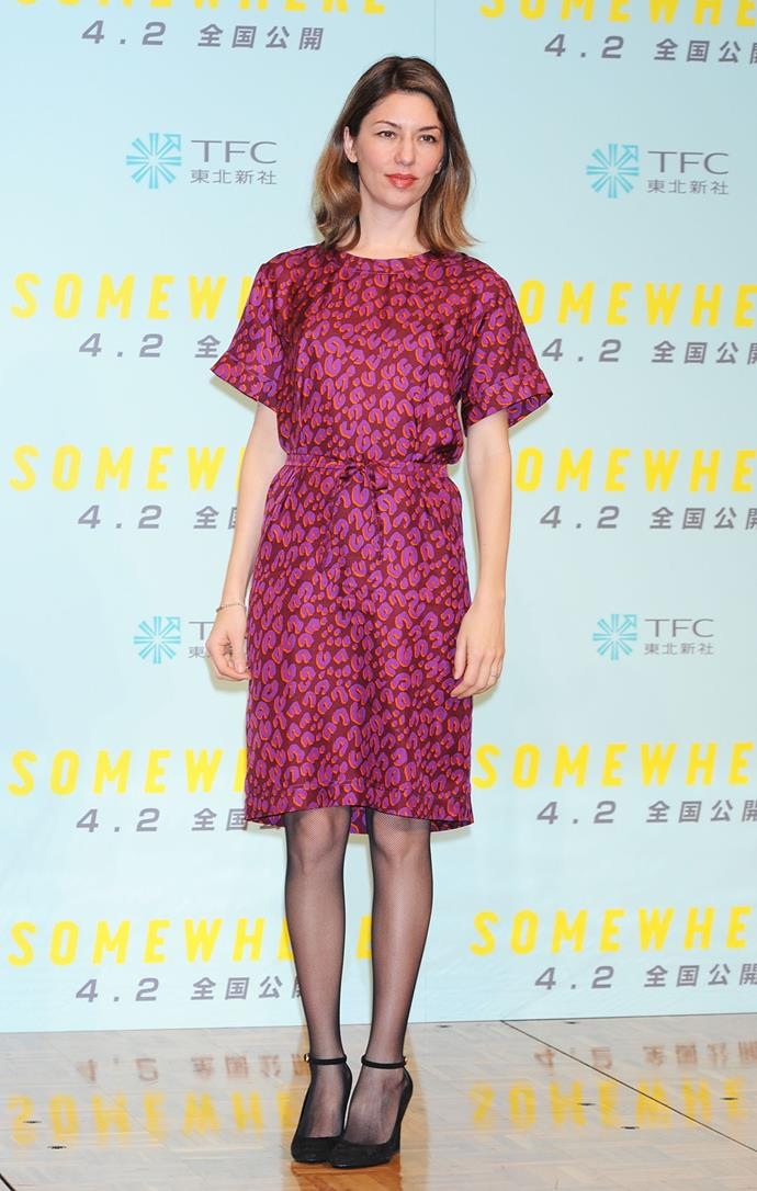 In Louis Vuitton at the Tokyo press conference for *Somewhere* in 2011.