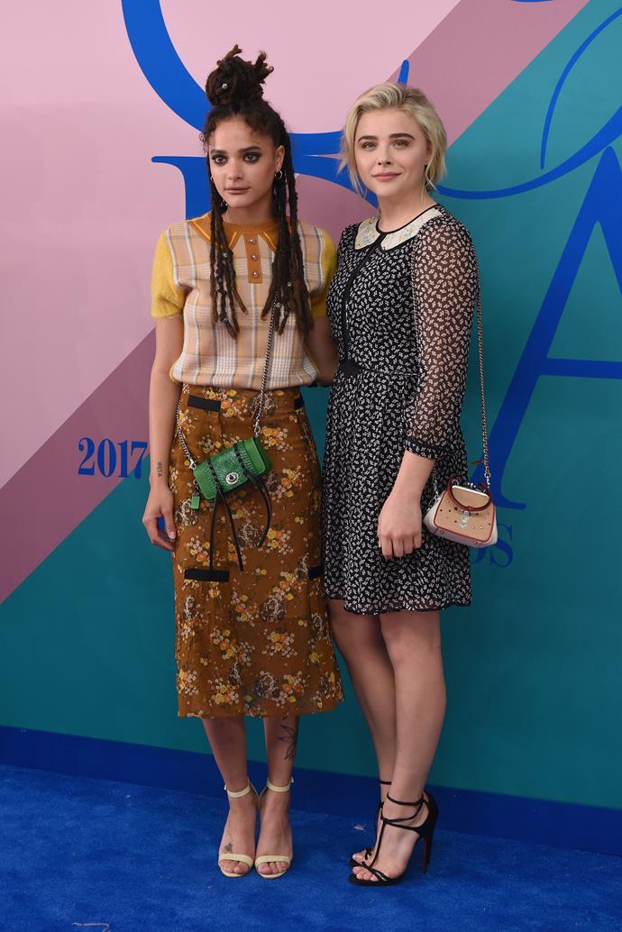 Sasha Lane and Chloe Grace Moretz in Coach.