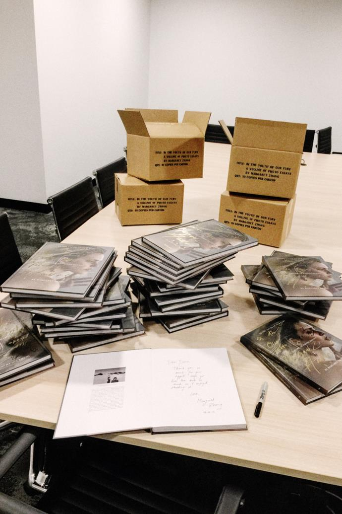 """""""Signing a run of my [*In The Youth Of Our Fury: A Volume of Photo Essays by Margaret Zhang*](http://shinebythree.com/product/in-the-youth-of-our-fury/) books for media and mates."""""""